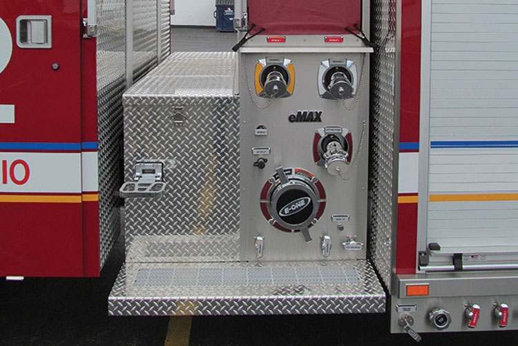 2 E-ONE offers its eMAX pump panel on both side-mount and top-mount (shown) pumpers, aerials, and tankers. The top-mount version gains two large compartments on each side and a very narrow pump module. (Photo courtesy of E-ONE