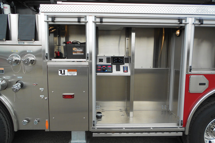 5 The Scorpion tandem-front-and-rear axle 104-foot platform built by HME uses an electronic pump panel in a forward compartment. (Photo courtesy of HME