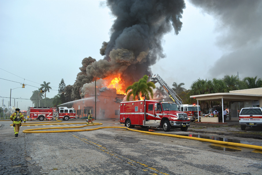 Palm Beach County (FL) Fire Rescue responded to find heavy smoke showing from all windows and doors of a two-story wood-frame building on concrete pilings. The building was abandoned and only used for storage. Because of the well-developed stage of the fire on arrival, the decision was made to go defensive. The fire was caused by a lightning strike. The ambulance pictured is Rescue 72, a 2009 International 4400 with a Horton Rescue Body and Horton HOP SRS system. (Photo by Michael Boike.)