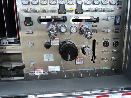 This pump panel behind a roll-up door has three gated steamer inlets plus a separate 2½-inch gated suction. A Storz/2½-inch adapter is a lot less expensive than the 2½-inch gated suction.