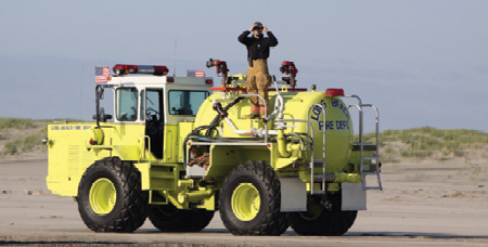 2Then-Lieutenant (now Chief) Bonney on 88-51. Note the two red remote-controlled 2½-inch monitors, the white 2½-inch handheld monitor, and the old lightbar with white and amber lights at the bottom. For vehicle scale, Bonney is six feet tall.