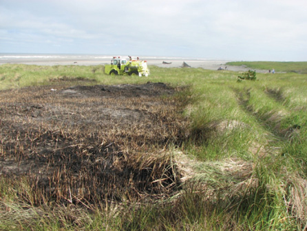 488-51 at the scene of a dune grass fire. Note the tire tracks in the grass on the right of the photo. This is a tactic 88-51 drivers use to flatten the grass to slow the spread of larger fires