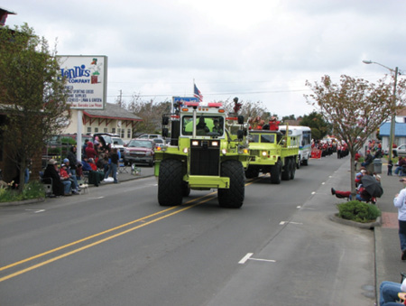 688-51 at a parade. Note the new lightbar, wide tires, and spacious cab. A remote monitor joystick can be seen on the left side of the cab.