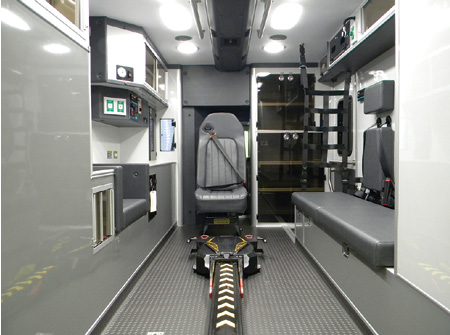 4The interior of the PL Custom ambulance features a Stryker Power-Load system and a three-point seat belt harness for the captain's chair at the head of the cot and for and streetside seating.