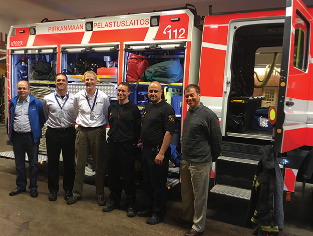 3Ted Billick (second from left) and Chris Mc Loone (third from left) with Tampere Region Rescue Department and Bronto Skylift personnel.