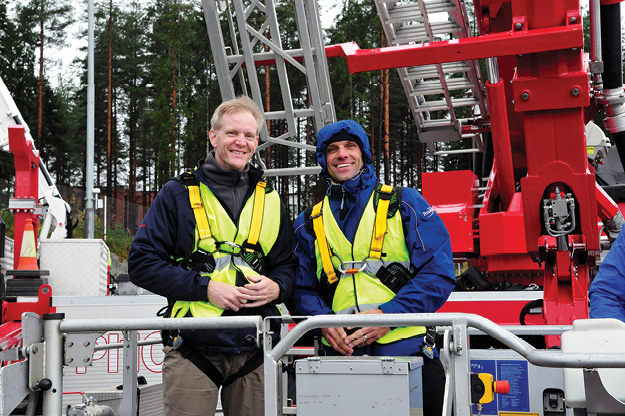 7Chris Mc Loone (left) and Ted Billick (right) smiling after their trip on a 37-meter Bronto Skylift unit.