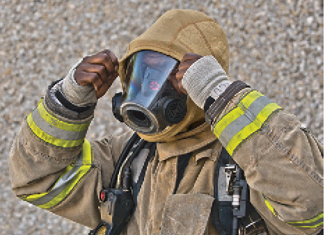 7A firefighter dons a BarriAire Gold Hood made by PGI Inc. that gets its particulate blocking power from an inner layer of DuPont™ Nomex Nano Flex. (Photo courtesy of PGI Inc.)