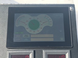 8An operator uses KME's handheld tethered controller to activate the aerial's auto leveling system.