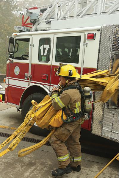 3Ladder crews practice deploying hose during a training evolution.