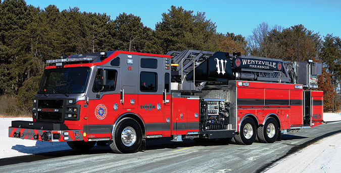 Rosenbauer—Wentzville (MO) Fire Department 100-foot midmount Cobra quint. Commander 7018 cab and chassis; Cummins ISX15 600-hp engine; Waterous S100 2,000-gpm pump; Pro Poly 750-gallon polypropylene tank; Rosenbauer Green Star 11.5-kW generator system with idle reduction technology; hot dipped galvanized painted aerial. Dealer: Brian Franz, Sentinel Emergency Solutions, Arnold. MO. (Photo by Paul Barrett.)