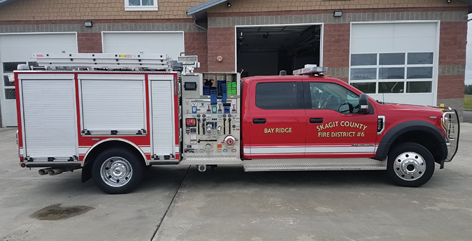 Darley—Skagit County Fire District #6, Burlington, WA, WASP Polyvision quick-attack unit. Ford F-550 cab and chassis; Ford Power Stroke 6.7-liter 8-cylinder 330-hp engine; Darley Champion PSMC 1,500-gpm pump; PolyBilt fire body with integral 305-gallon tank and 30-gallon foam cell; FoamPro 1601 single-agent foam system. Dealer: Neal Brooks, W.S. Darley, Braceville, IL.