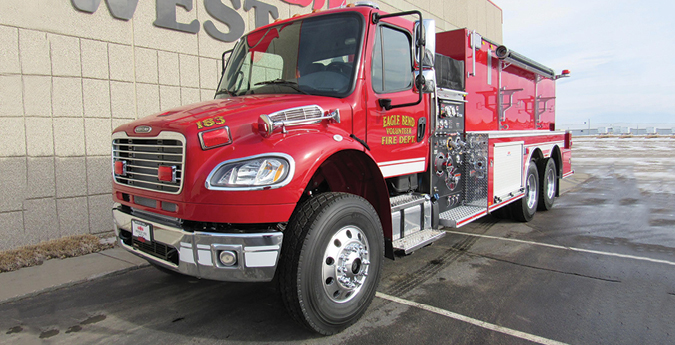 """Midwest Fire—Eagle Bend (MN) Fire Department pumper-tanker. Freightliner M2 cab and chassis; Cummins L9 350-hp engine; Darley LSP 1,000-gpm pump; APR polypropylene 3,000-gallon tank; 8-gallon foam cell; 3 Newton 10-inch square dump valves; FoamPro 1600 single-agent foam system; stainless steel """"tip down"""" portable tank carrier and 3,000-gallon portable tank. Dealer: Rick Peterson, Midwest Fire, Luverne, MN."""