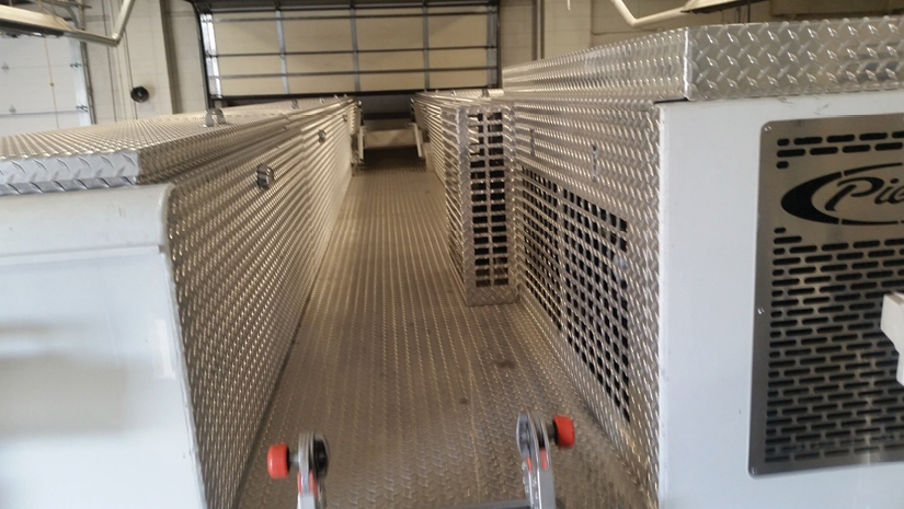 2The trailer's roof aisle showing the nine compartments on top and the rear drop-down ladder at the end of the aisle. (Photo courtesy of Greg Pixley.)