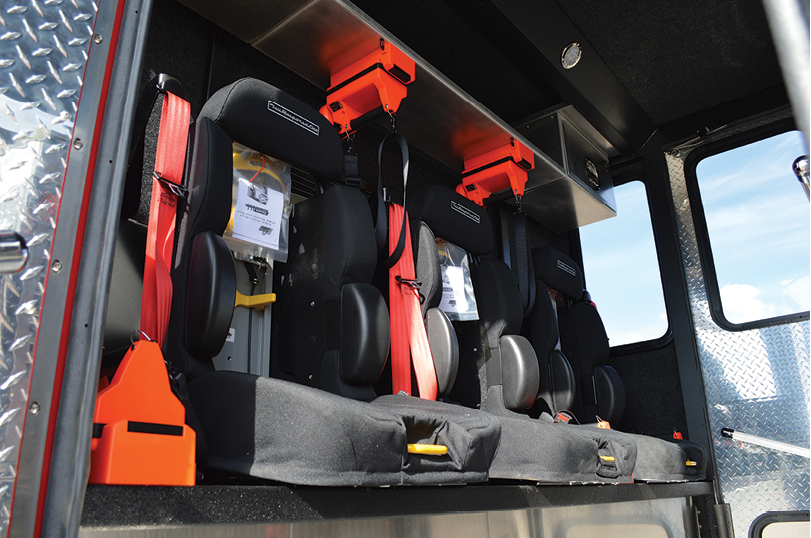 5Storage cabinets are placed above and below the three rear-facing seats in the enclosed cab.