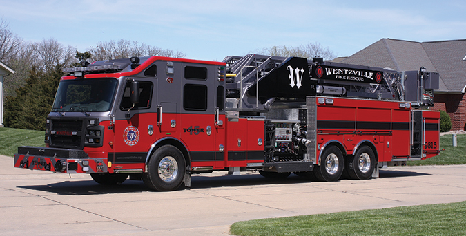 Rosenbauer—Wentzville (MO) Fire Protection District 100-foot midmount platform quint. Commander 4000 cab and chassis; Cummins ISL 600-hp engine; Waterous S100 single-stage 1,750-gpm pump; Pro Poly 300-gallon polypropylene tank; 30-gallon foam cell; built-in foam eductor for Class B foam; front-bumper-mounted hose reel; Whelen LED lighting package. Dealer: Brian Franz, Sentinel Emergency Solutions, Arnold, MO.