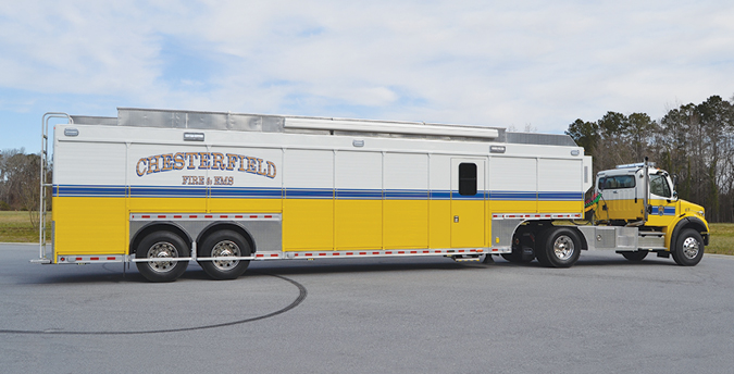 VT Hackney—Chesterfield (VA) Fire & EMS technical rescue trailer. Freightliner M2 tractor; Cummins L9 450-hp engine; 39.25-foot VT Hackney 18-compartment drop deck trailer with work center; Powertech 15-kW generator; Jenny air compressor7.9-CFM; Whelen LED warning lights and siren package; rooftop coffin storage compartments; Girard electrical awning. Dealer: Pete Laake, FESCO Emergency Sales, Elk Ridge, MD.