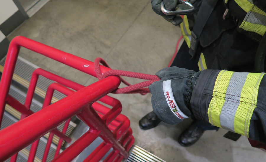 Tying off a search rope while wearing firefighting gloves can be difficult, especially in a dark, smoky environment, and can slow down the search team.