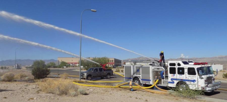 A quick-attack unit and a Bullhead City (AZ) Fire Department pumper flowing during big water unit flow tests.