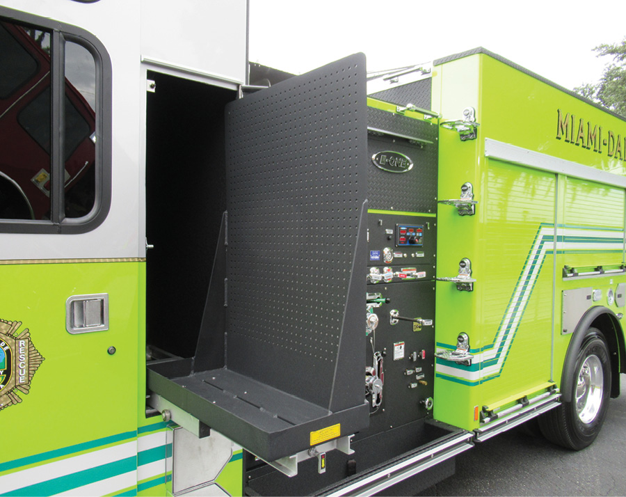The suppression units the department has acquired have a transverse compartment behind the crew cab that has two slide-out tool boards designed to hold SCBA, thus keeping the SCBA out of the crew cab area. (Photo courtesy of E-ONE.)