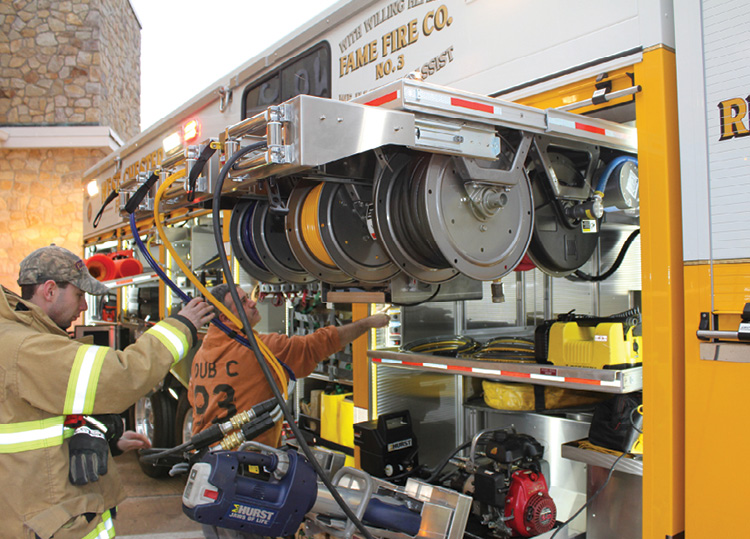 Fame (WI) Fire Co. No. 3 uses Hannay reels on a sliding rack for its hydraulic hose reel needs. (Photo courtesy of Hannay Reels and CustomFIRE Apparatus.)