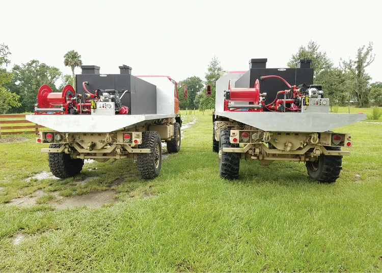 These two flatbed pumpers carry 1600 Series Cox Reels for one-inch booster hose.