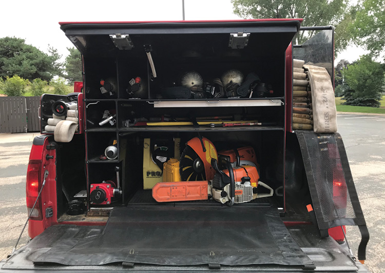 Tank, pump, self-contained breathing apparatus (SCBA), tool storage, hosebed, and a preconnected handline all needed to be stored without removing or modifying the truck box.