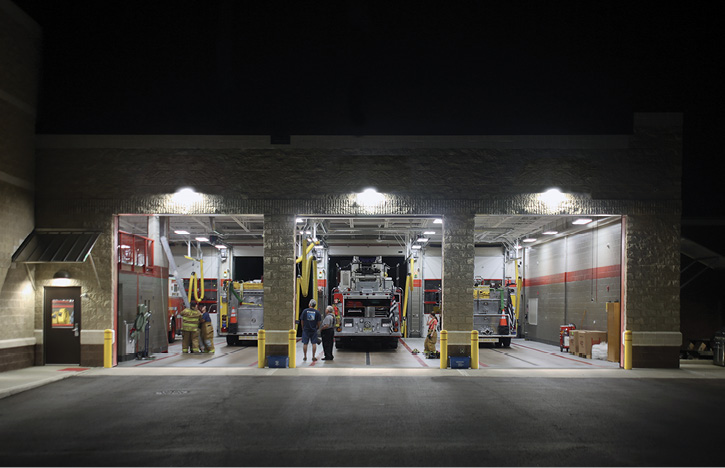 The rear of the South River fire station showing the back entrance to the three drive-through double-deep apparatus bays. The station also has two back-in bays.