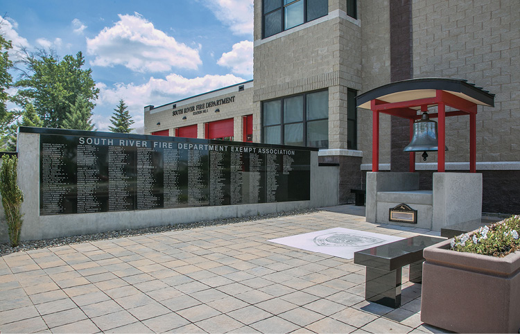 The front of the South River fire headquarters features a memorial for deceased firefighters.