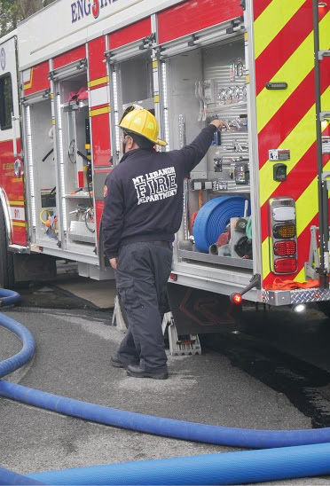 The pump panel is located in the end compartment on the driver's side.