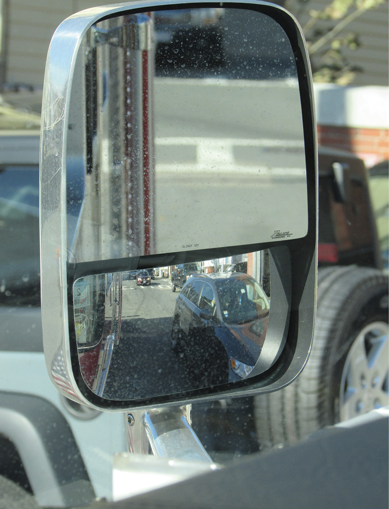 """all three axes are in view, but not in the """"bus"""" mirrors in photo 6."""