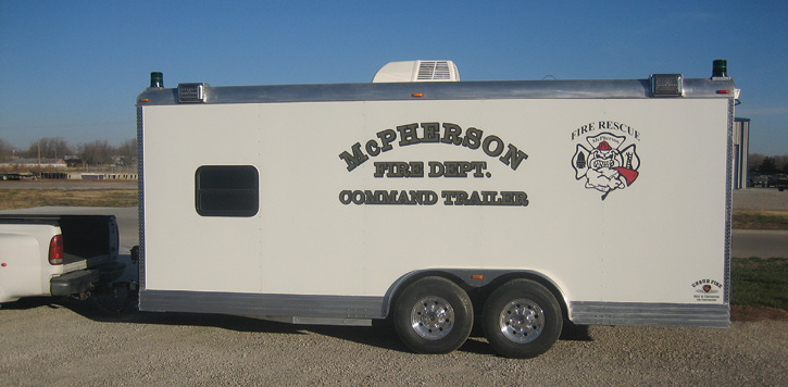 The McPherson (KS) Fire Department had Unruh Fire build this 20-foot bumper-pulled command trailer hauled by a Ford F-250 pickup truck.