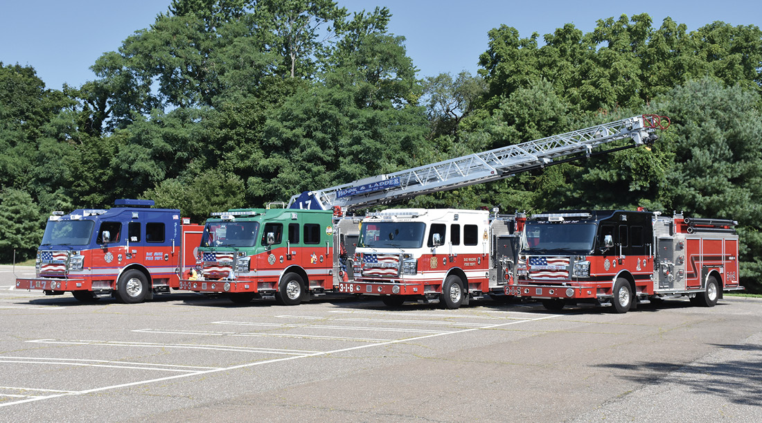 Lineup of all three: Rosenbauer Commander engines and Rosenbauer Viper 109-foot rear-mount ladder. Each company chose a different color for the top of the cab. (Photos by author.)