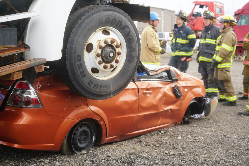 Semi-truck crushes car while firefighters practice rescuing