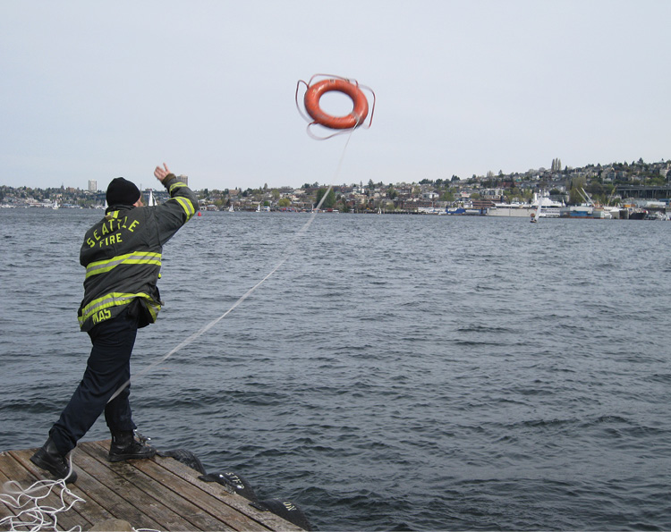 Throwing a life ring with accuracy is easier said than done. Drownings are low-frequency events, so when the life ring is needed, you better be accurate. Nothing looks worse to the public than a professional charged with saving a life, swinging a rope with a life ring, only to have it get stepped on or snagged in a bush or a tree.