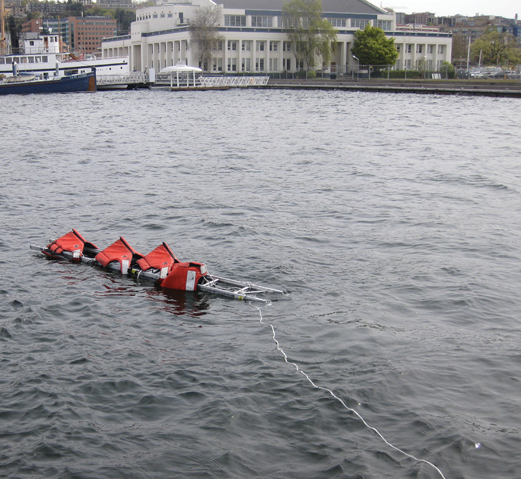 Victims in the water can grab onto any part of the ladder. This setup allows for numerous victims to be rescued and towed to shore simultaneously.