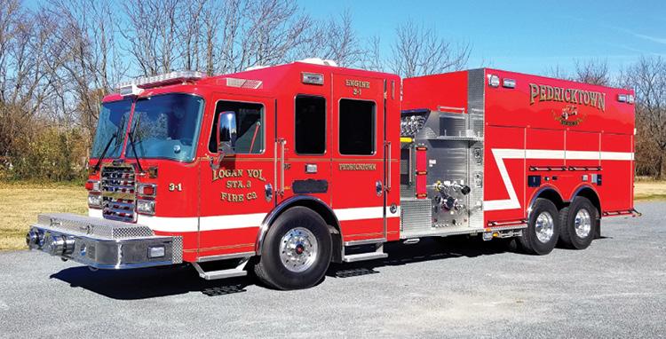 KME—Logan Volunteer Fire Company, Pedricktown, NJ, pumper-tender. Predator cab and chassis; Cummins X15 600-hp engine; Hale Qmax 2,000-gpm pump; UPF Poly 2,800-gallon tank; 20- and 30-gallon foam cells; FoamPro 2001 dual-agent foam system; Onan 10-kW generator; Will-Burt Night Scan NS2.3-920 light tower; two Norton 10-inch side dump valves with chutes; Dealer: Skip Stringer, 1st Priority Emergency Vehicles, Manchester, NJ. (Photo by Dennis C. Sharpe.)