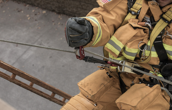 A firefighter uses CMC Rescue's LEVR descent device during a bailout exercise.