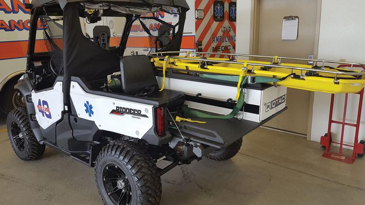 This QTAK EMS-F rescue skid is shown on a 4x4 Honda Pioneer UTV.