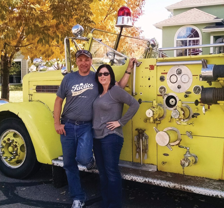 Maloney and his wife, Victoria, stand next to his fire truck. (Photo courtesy of Kevin Maloney.)