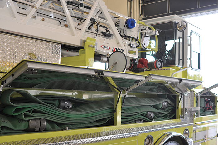 7 The hosebed on the driver's side of the tiller quint carries 600 feet of four-inch LDH.