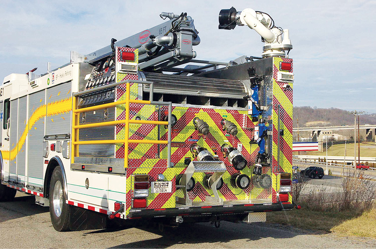 Summit Fire Apparatus built this rear-mount pumper for BP on a Spartan custom chassis with a pulpit-mount pump panel located on the left side of the vehicle above a slide-out platform where the operator stands. (Photos 6 and 7 courtesy of Summit Fire Apparatus.)