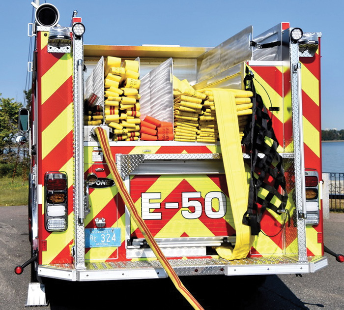 Engine 50 preconnected a 1¾-inch trash line on its rear discharge. The ladder tunnel on the right side of the hosebed holds a 20-foot two-section extension ladder, backboards, and pike poles.