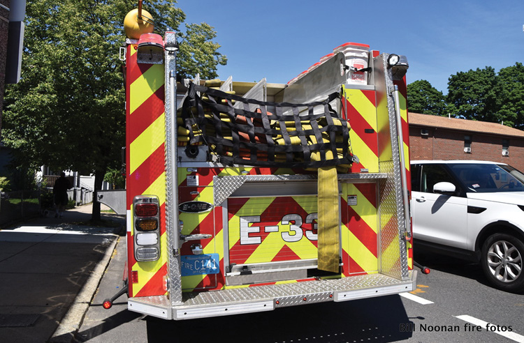 Engine 33 has utility storage above the ladder tunnel. The rear-step compartment is modified to hold LDH preconnected to a hydrant valve. The rear discharge has a reducer but no preconnect. The full-width, 14-inch-deep rear step (aka tailboard, backstep, and politically correctly a rear work platform) has tapered corners to assist in backing into tight areas. A ¾-inch-wide intermediate treadplate step is also provided.