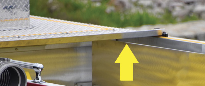 The hinged treadplate windscreen at the front of the hosebed prevents aerodynamics from lifting up and launching packed hose.