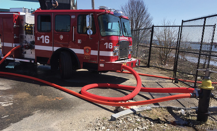 """Engine 16 makes a big fire hookup with a """"looped"""" 5-inch preconnected front suction. Adding an additional 3-inch line from the plug to a gated siamese on the right steamer connection can achieve 1,800 gpm through the Darley """"large-eyed impeller"""" 1,250-gpm pump."""