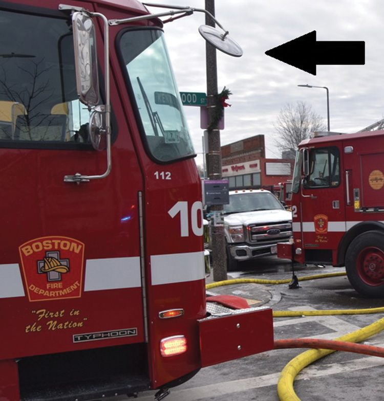 """Engine 10's oversized """"front bumper mirror."""" School buses have similar mirrors to ensure kids are not inadvertently hit. Boston uses them to help make tight turns and negotiate congested traffic."""
