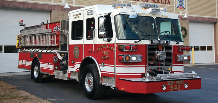 ETA-543's officer side of the apparatus has the quick blitz hose storage with the Elkhart Brass Ram XD.