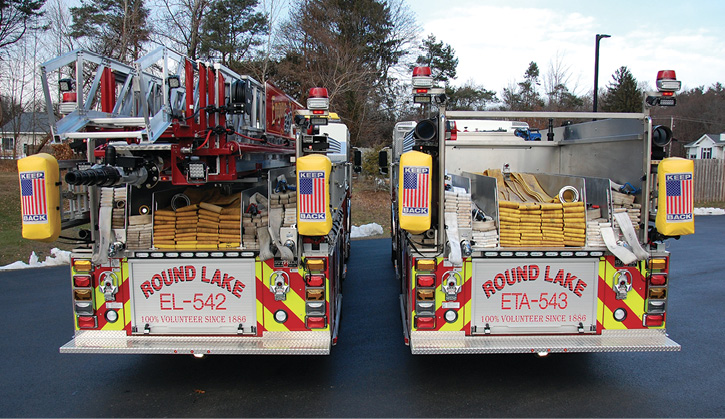 The rear of both Round Lake Sutphen apparatus with low hosebeds and multiple attack line storage