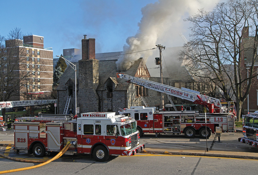 Fire ripped through a 94-year-old church in New Rochelle, New York. About 60 firefighters at this three-alarm fire held the fire to two sections of the large L-shaped building and out of the main sanctuary. New Rochelle Fire Department Ladder 12 is a 2013 Spartan ERV 103-foot rear-mount aerial; Engine 23 is a 2014 Spartan/Smeal 1500/500 pumper. (Photo by Michael Messar.)