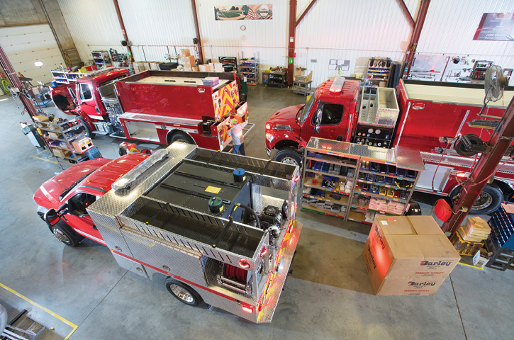 This interior view shows two tanker-pumpers and a brush truck in various stages of construction. Owner Sarah Atchison says the terminology tanker-pumper is a term Midwest uses in-house. There is no difference between it and a pumper-tanker.
